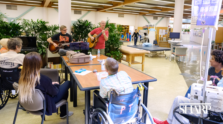 Volunteers play music for patients