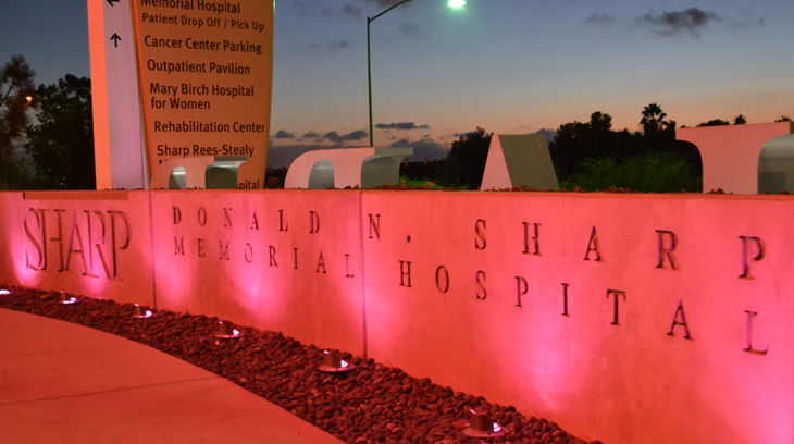 Sharp Memorial Hospital's sign glows pink