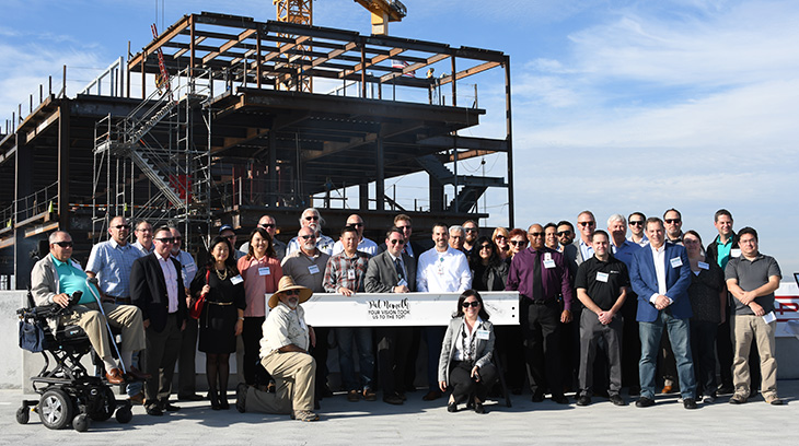 Members of the Sharp HealthCare and design-build (Hensel Phelps Construction, AVRP Skyport and SmithGroupJJR) teams, volunteers, donors and community leaders at the topping out ceremony on Nov. 16, 2017.